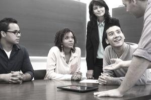 Business school students talking in classroom