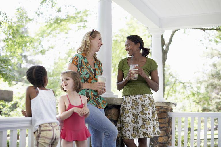 neighbor women talking and kids playing