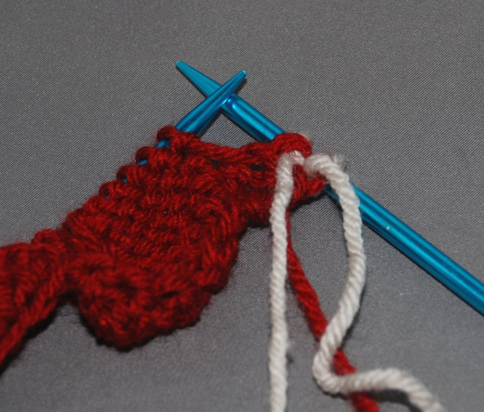 Red yarn on knitting needles