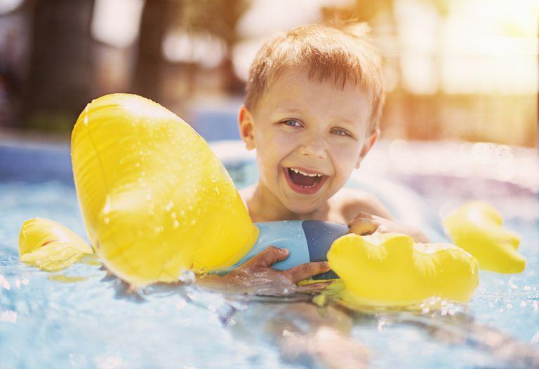 Boy in innertube floating in pool