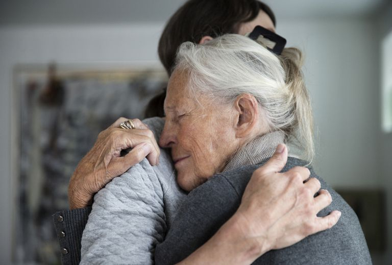 Senior mother and daughter hugging