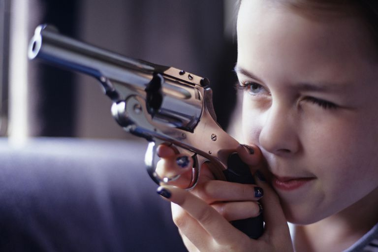 Girl playing with handgun