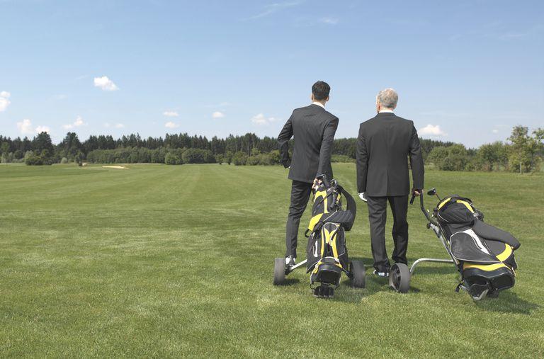 Business executives on a golf course