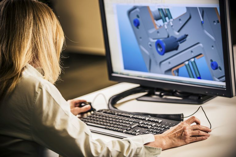 Woman designing something on a computer