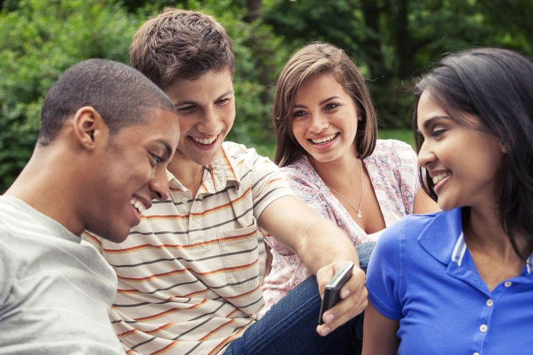 group of teens smiling and talking