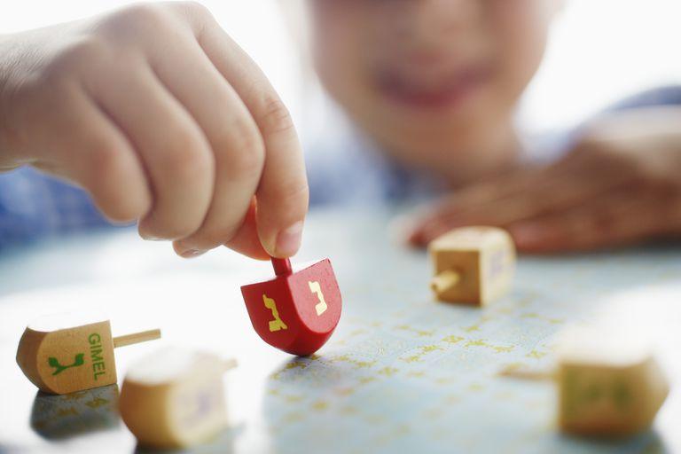 Young boy playing dreidel