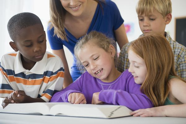School children practice reading troubled with Dyslexia