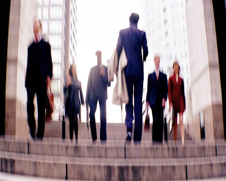 Businesspeople walking through square (defocussed)