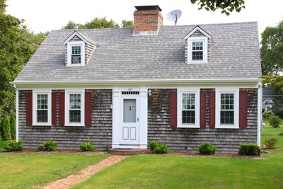 New England House With Grey Shingles Two Small Dormers Without Shutters Red On