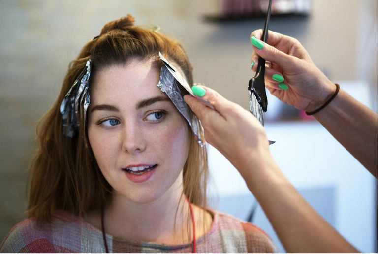Young Woman Having her Hair Dyed at a Salon