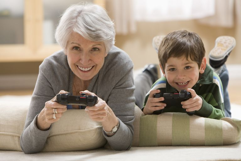 Image of a grandmother and grandson playing a game, illustrating About.com's Toy Sweepstakes List.