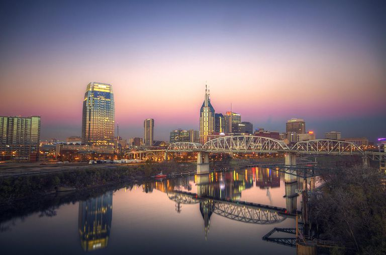 Pre-morning light fills the sky and shines on a quiet and peaceful looking Nashville skyline