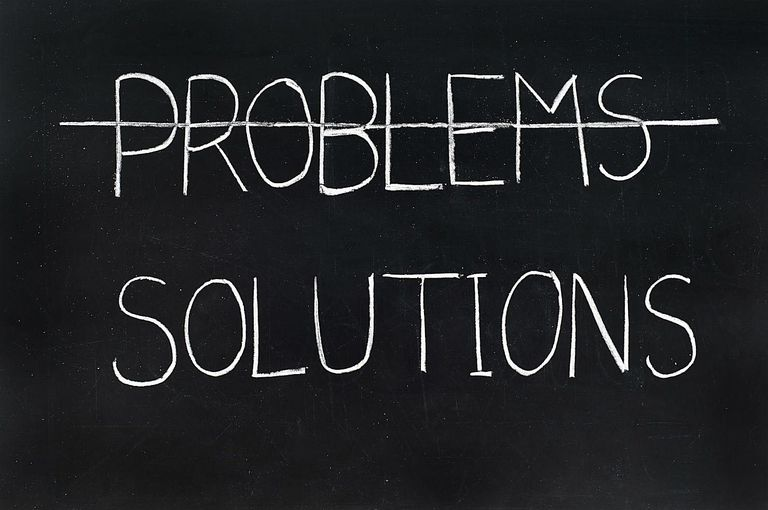 Chalkboard with two words: Problems and Solutions. Problems is crossed out.