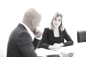 Businessman and businesswoman in conference room
