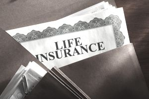 Life insurance policy in a brown folder