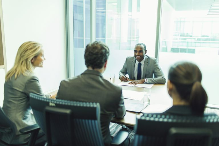 man in job interview with three executives