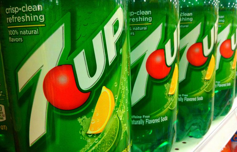 Liter bottles of 7UP on a grocery shelf