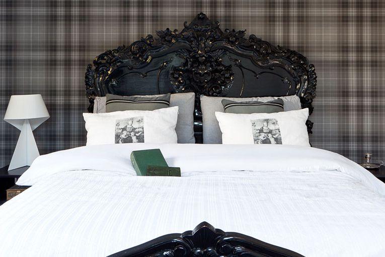 bedroom with black plaid walls