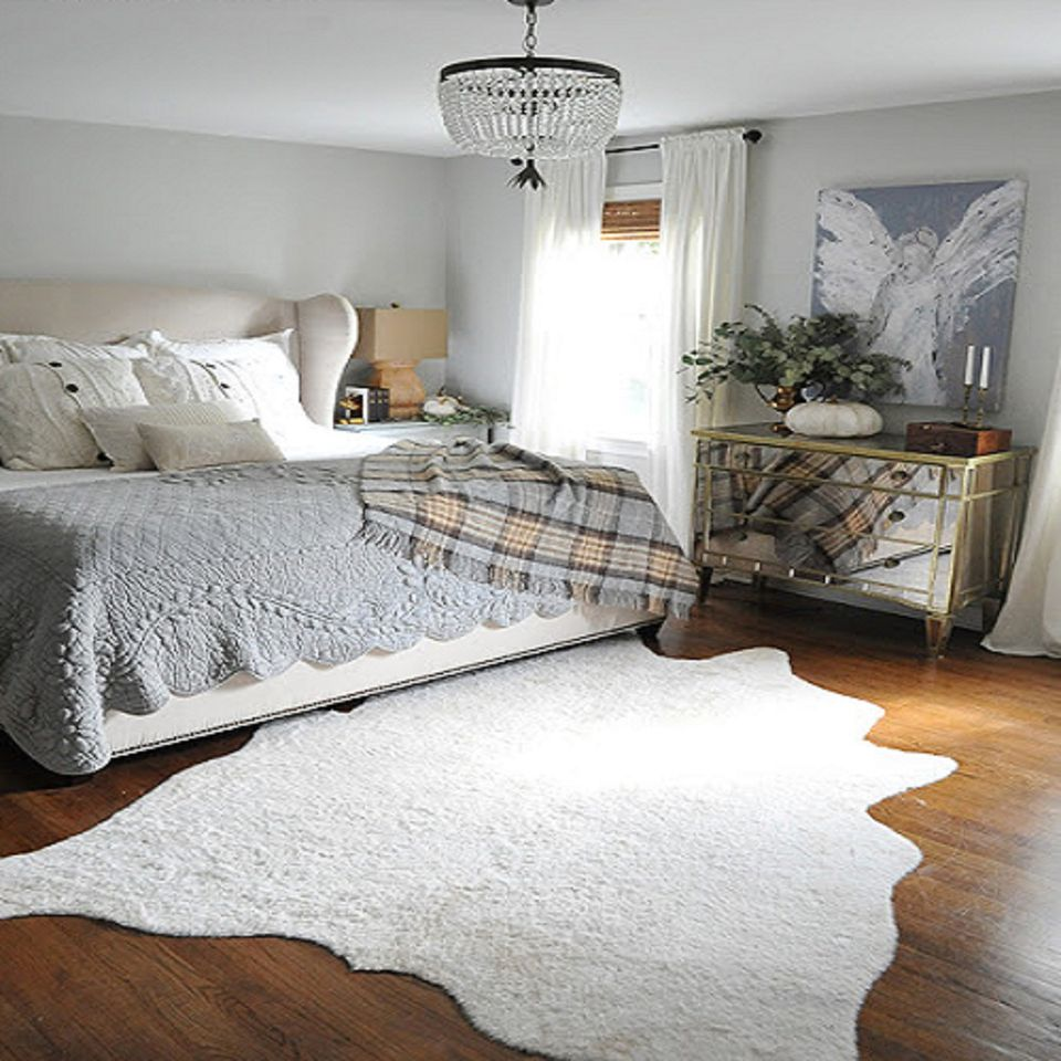 It's the Little Things: Quirky Rug. Pretty gray bedroom