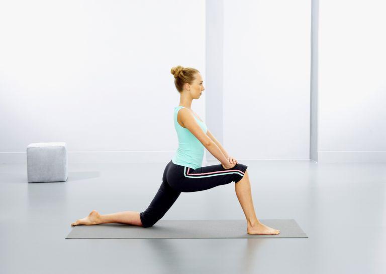 Woman practising yoga lunge exercise