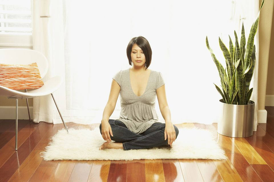 Asian woman sitting on floor