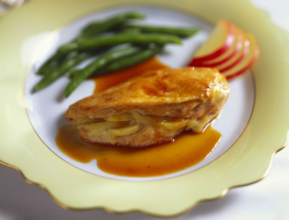 A plate of apple and brie stuffed chicken breasts