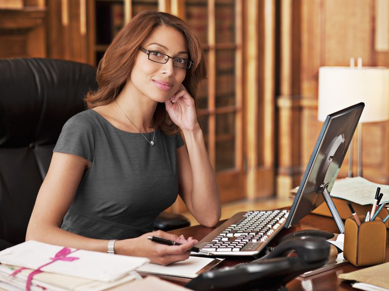 business woman at office desk computer