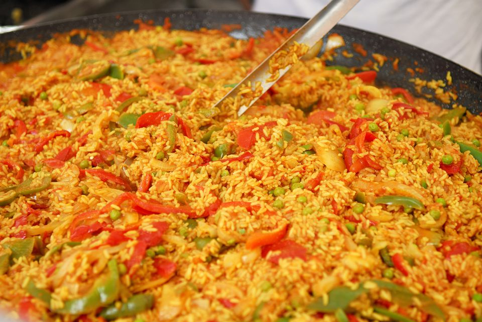 Vegetarian and vegan spanish paella recipe vegan paella with green peas artichokes and bell pepper photo by fuse getty images forumfinder Choice Image
