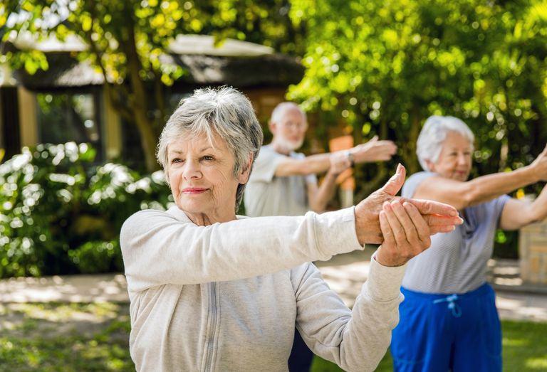 Senior women exercising outside