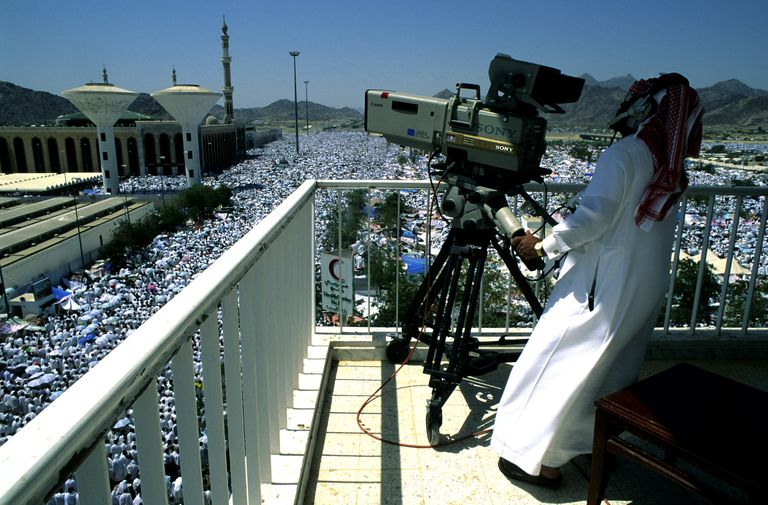 A Saudi TV cameraman during the Hajj in Arafat, Mecca, Saudi Arabia.