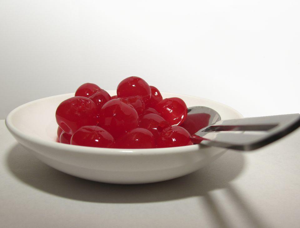 Bowl with bright red sweet maraschino cherries