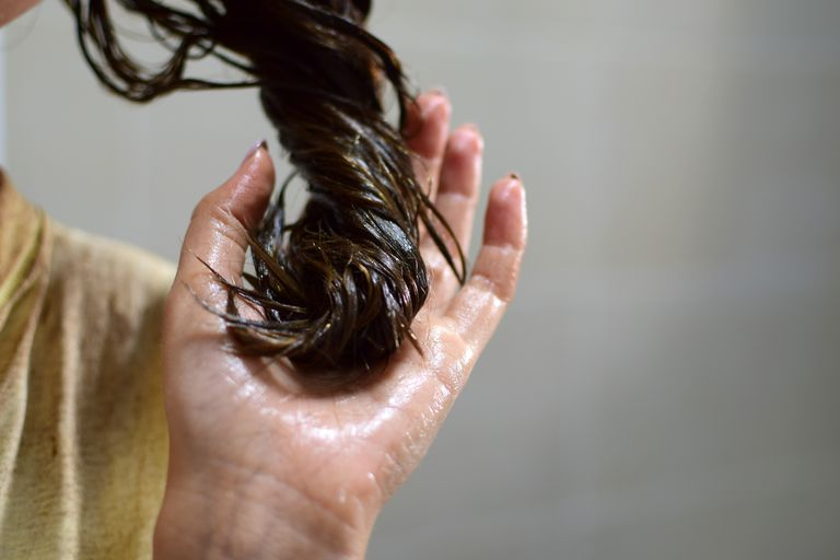 Close-up of oiled hair
