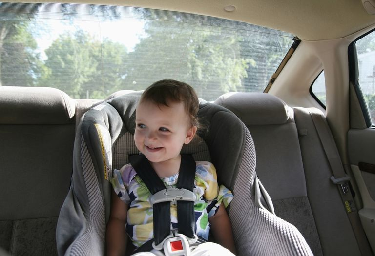 A young girl in a car seat in the back of the car;Minneapolis minnesota usa