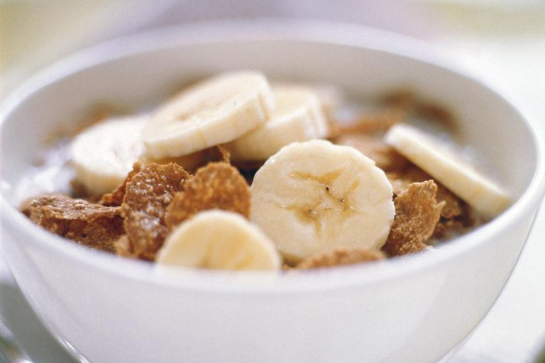 Bowl of corn flakes with banana slices