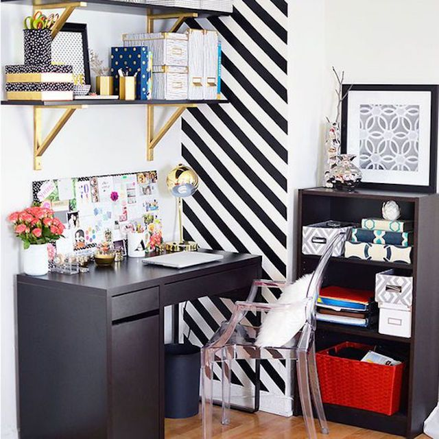 home office with diagonal striped wallpaper feature wall
