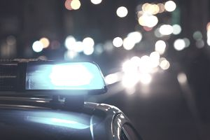 Close-Up Of Blue Siren On Police Car At Night