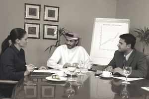 business meeting including man wearing a keffiyeh