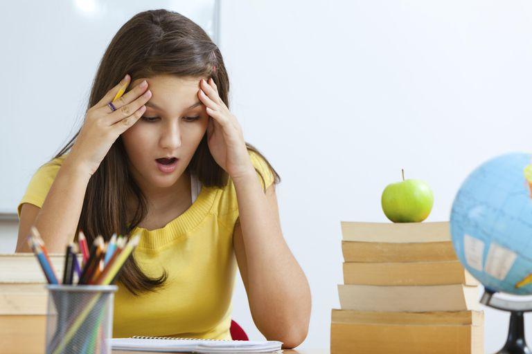 Frustrated teenage girl doing homework