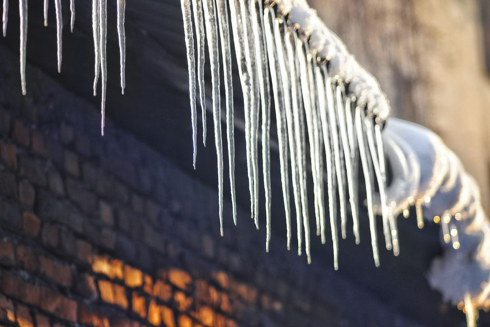 Low Angle View Of Icicles On Roof