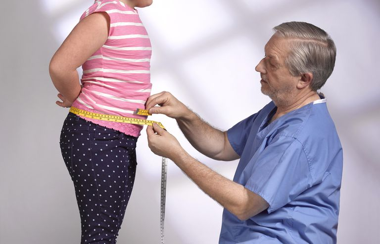 Overweight girl with doctor