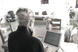 Woman at home using her laptop