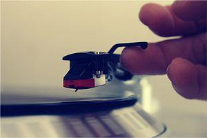 Man playing vinyl record
