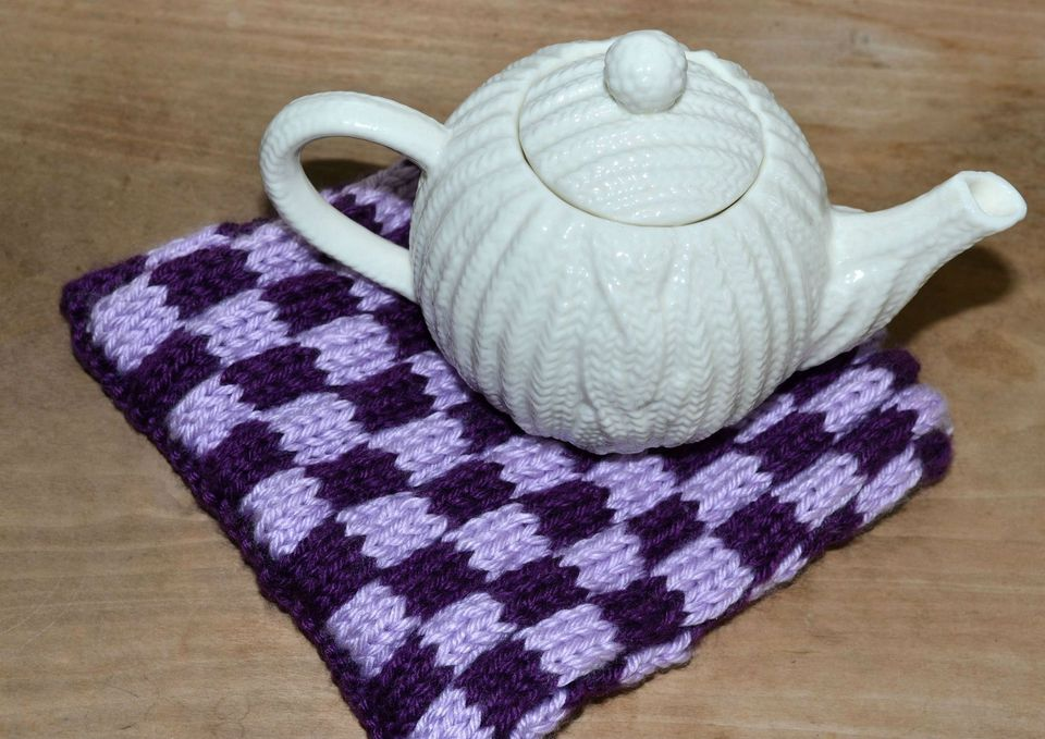 Checkerboard Stitch is an eays way to learn to knit with two colors in a row.