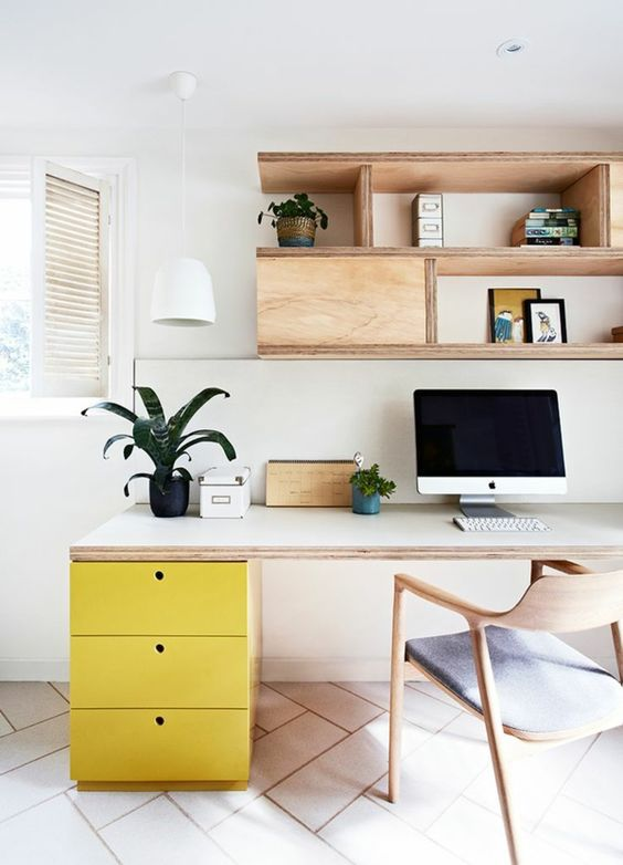 Bright yellow furnishings in a stylish home office