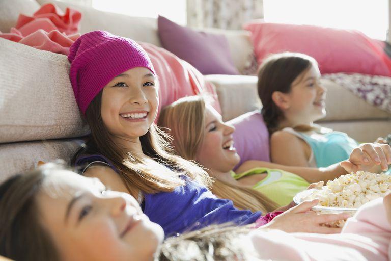 Girls watching movies at slumber party