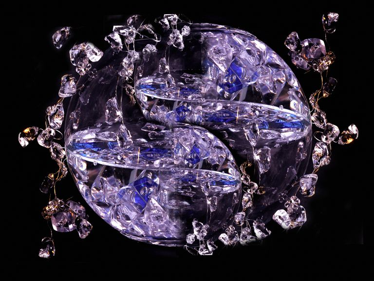 Crystals grow by nucleation of atoms or molecules to form organized structures.