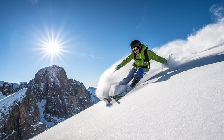 Man skiing off piste, Dolomites, Italy