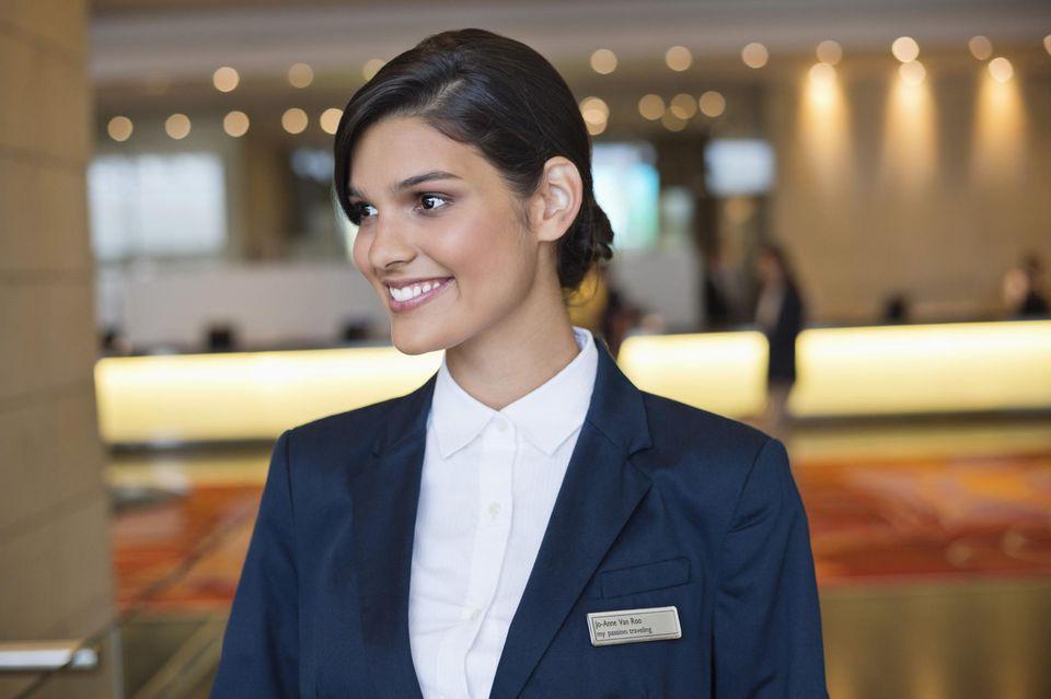 Hotel clerk at reception desk