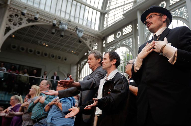 Members of Streetwise Opera perform 'O Sole Mio' in the Paul Hamlyn Hall of the Royal Opera House on July 2, 2012.