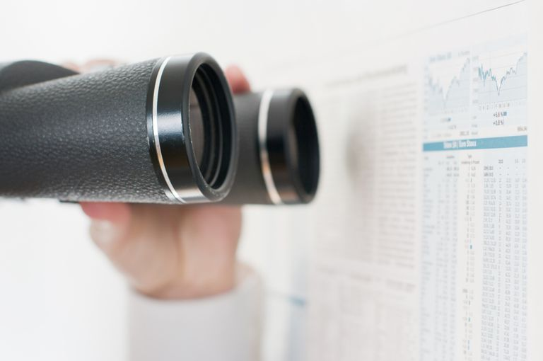 Binoculars looking at charts
